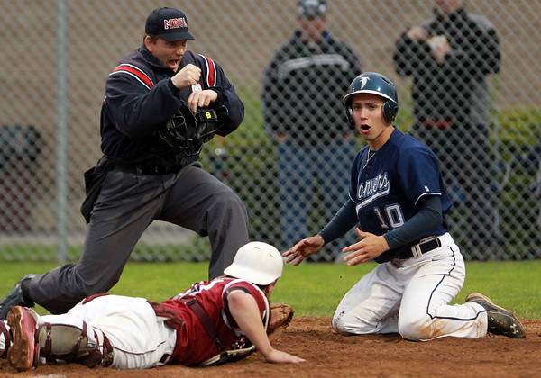 Danvers: Danvers senior Joe Strangie reacts to an out call by the home plate umpire after he was tagged out by Gloucester catcher Jordan Pallazola on a close play at the plate. David Le/Salem News