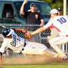 Danvers: Danvers first baseman Rafael Tylus (11) tries to slide back into third base, but is tagged out by Tewksbury third baseman Joe Csokmay, after a brief rundown between home and third. David Le/Salem News