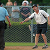 Danvers: Danvers baseball Head Coach Roger Day argues a controversial play at the plate. David Le/Salem News