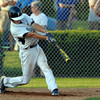 Danvers: Danvers senior catcher Joe Olszak lines a single against Tewksbury on Friday evening. David Le/Salem News