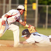 Danvers: Danvers senior Dan Connors stretches out to try and touch second base ahead of a tag from Tewksbury shortstop Dom Rosado, left, on a steal attempt during the 4th inning of play. David Le/Salem News