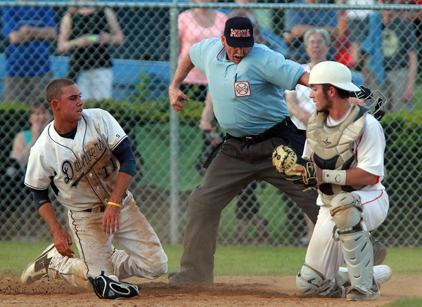 Danvers: Danvers first baseman Rafael Tylus, left, is called out at the plate by the home plate umpire even though Tewksbury catcher Cam Oliveira dropped the ball. David Le/Salem News
