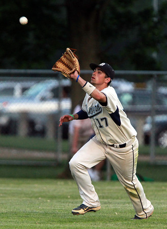 Danvers: Danvers right fielder AJ Couto snares a fly ball to record an out in the 6th inning of play against Tewksbury on Friday evening. David Le/Salem News