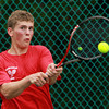 Marblehead: Marblehead junior Chris Wigglesworth returns a serve during first singles action against Manchester-Essex on Thursday afternoon. David Le/Salem News