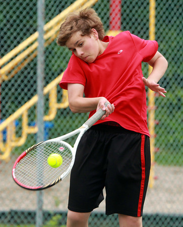 Marblehead: Marblehead second doubles player Michael Forte returns a serve against Manchester-Essex on Thursday afternoon. David Le/Salem News
