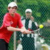 Marblehead: Marblehead second singles player Miles Barry concentrates on the ball while returning a volley against Manchester-Essex on Thursday afternoon. David Le/Salem News