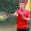 Marblehead: Marblehead senior Alex Rothbard returns a volley during second doubles play against Manchester-Essex on Thursday afternoon. David Le/Salem News