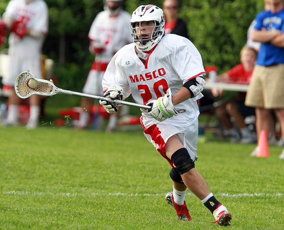 Topsfield: Masco Midfielder Dylan Mann (20) looks to make a pass against Braintree on Tuesday afternoon. David Le/Salem News 5/28/13