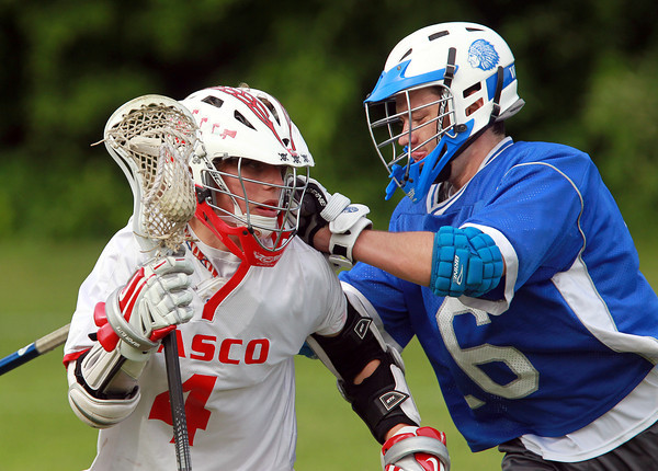 Topsfield: Masco Sophomore Cam Jung (4), left, drives to the net past Braintree defender Mike Milward on Tuesday afternoon. Jung scored 6 goals to lead the Chieftans past the Wamps 12-10. David Le/Salem News 5/28/13