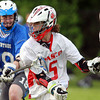 Topsfield: Masco Attack Max Craig (5) protects the ball behind the net while being hassled by Braintree defenseman John Elworthy, left, on Tuesday afternoon. David Le/Salem News 5/28/13