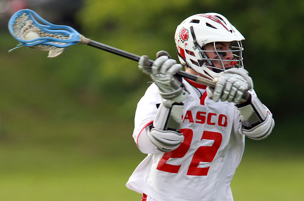 Topsfield: Masco Midfielder Henry Behrens (22) unleashes a shot on net against Braintree in the first round of the MIAA D1 North Tournament. David Le/Salem News 5/28/13