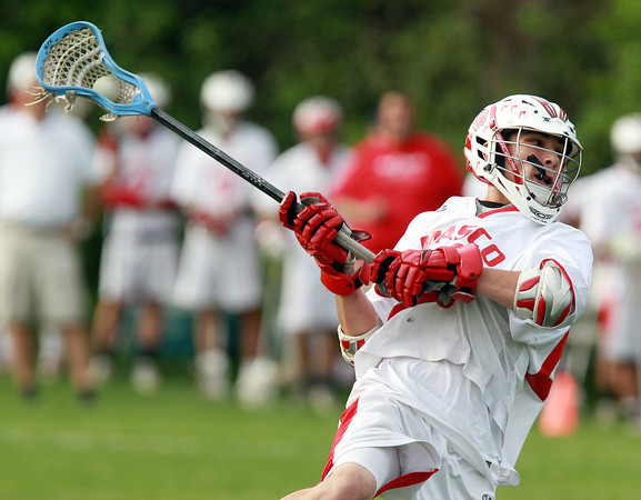 Topsfield: Masco Midfielder Harry Cwik (28) leaps in the air and rifles a shot against Braintree during the first quarter of play on Tuesday afternoon. David Le/Salem News 5/28/13