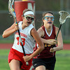 Boxford: Masco midfielder Becca Phillips protects the ball and drives past Newburyport's Mary Pettigrew, right, on Friday evening. David Le/Salem News