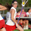 Boxford: Masco's Maddy Doyle looks to make a pass against Newburyport on Friday evening. David Le/Salem News