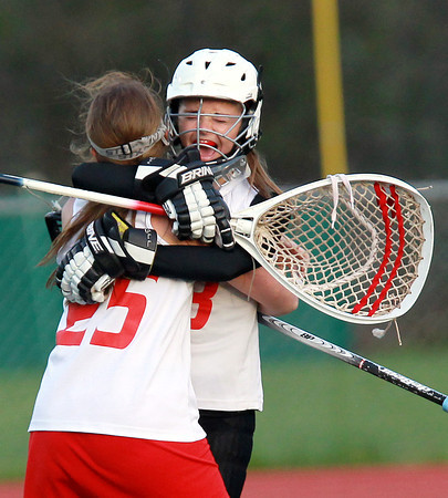Boxford: Masco goalie Lili Miller, right, screams in excitement while getting hugged by teammate MaryLee Hutchinson, after the Chieftans captured the CAL Girl's Lacrosse Title with an 11-6 win over Newburyport on Friday evening. David Le/Salem News