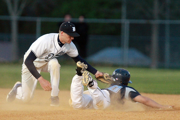 Danvers: Danvers second baseman Dan Connors applies the tag to Peabody's George Tsonis as he slides into second base. The throw from Danvers catcher Joe Olszak was on the money, throwing out his second Peabody baserunner of the evening. David Le/Salem News