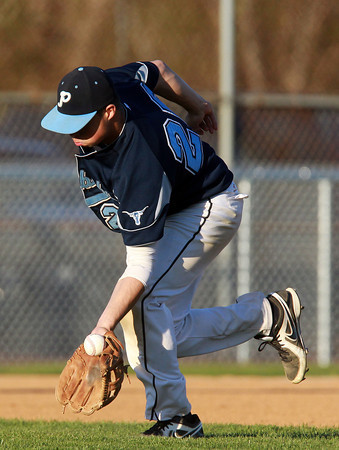 Danvers: Peabody third baseman George Tsonis makes the scoop on a tough hopper in the second inning of play. David Le/Salem News