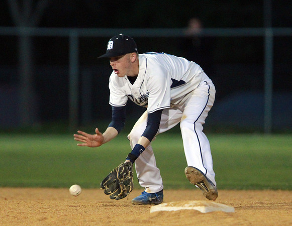 Danvers: Danvers shortstop Evan Eldridge fields a grounder and fires to first to record an out. David Le/Salem News