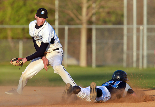 Danvers: Danvers second baseman Dan Connors looks to tag Peabody's Robert Crovo as he slides into second base on a steal attempt. David Le/Salem News