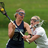 South Hamilton: Pingree senior midfielder Caroline Winslow rips a shot on net while being pressured by a Governor's Academy defender. David Le/Salem News