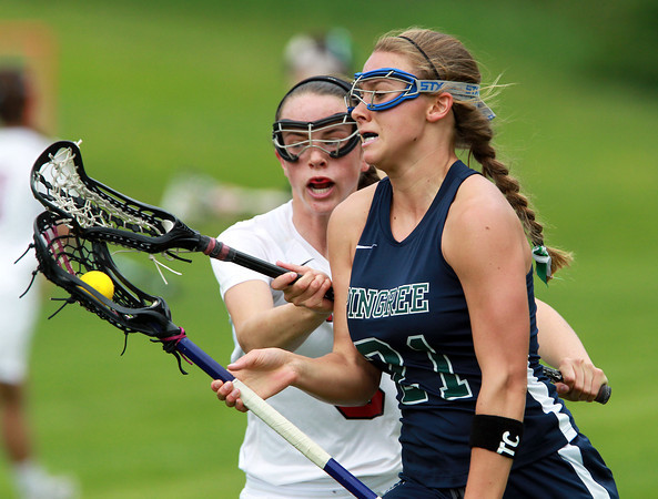 South Hamilton: Pingree senior Caroline Winslow drives past a Governor's Academy player during the first half of play on Saturday afternoon. David Le/Salem News
