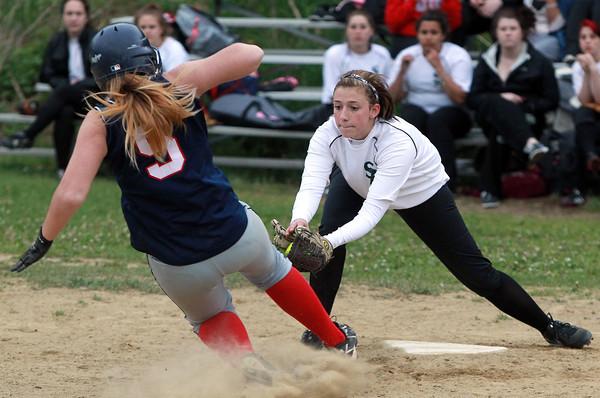 Salem: Salem Academy freshman Tara Deschenes tags a sliding Prospect Hill baserunner out at a close play at home plate. David Le/Salem News