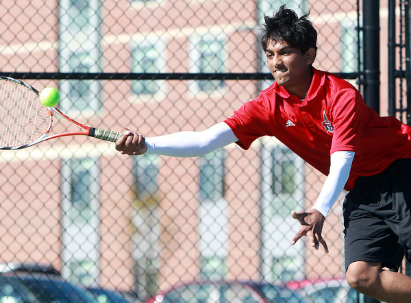 Salem: Senior captain Tahmid Raji lunges and returns a volley while playing in the first singles match against Gloucester on Tuesday afternoon at Salem State University. David Le/Salem News