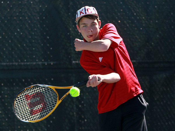 Salem. Salem High School freshman Guthrie Scimgeour keeps his eyes on the ball against Gloucester in third singles play. David Le/Salem News