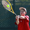 Salem: Third singles freshman Guthrie Scimgeour keeps his eyes on the ball as he returns a serve against Gloucester on Tuesday afternoon. David Le/Salem News