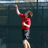 Salem. Salem High School senior captain Aidan Scrimgeour serves against Gloucester in the second singles match on Tuesday afternoon. David Le/Salem News