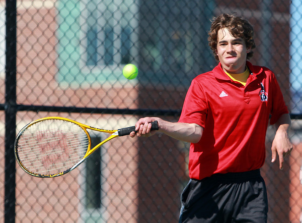 Salem. Salem senior captain Aidan Scrimgeour keeps his eyes on the ball as he returns a volley during second singles play against Gloucester on Tuesday afternoon. David Le/Salem News