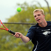 Danvers: St. John's Prep third singles player Dan Cunningham concentrates on the ball and returns a volley against Concord-Carlisle on Wednesday afternoon. David Le/Salem News