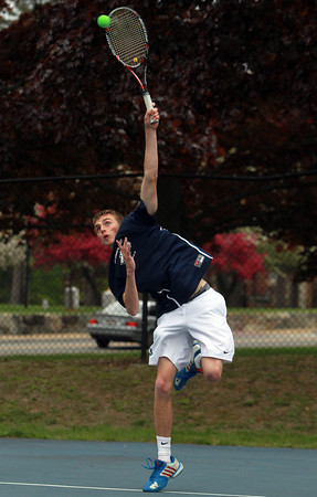 Danvers: St. John's Prep senior Ian Wright serves against Concord-Carlisle during first singles action on Wednesday afternoon. David Le/Salem News