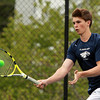 Danvers: St. John's Prep first singles player Alec McNiff concentrates while returning a serve on Wednesday afternoon against Concord-Carlisle. David Le/Salem News