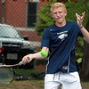 Danvers: St. John's Prep second singles player Nico Limacher returns a volley against Concord-Carlisle on Wednesday afternoon. David Le/Salem News