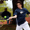 Danvers: St. John's Prep junior Sean Nork returns a serve against Concord-Carlisle on Wednesday afternoon in second doubles play. David Le/Salem News