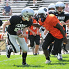 Beverly:  Peabody Raiders player Mark Murphy drives up with the ball closely watched by the Beverly defense during a seventh and eighth grade youth football game.  photo by Mark Teiwes / Salem News