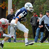 Danvers: St. John's Prep player Dillon Gonzalez speeds through an attemped tackle by Catholic Memorial's Josh Charles to score a touchdown.  photo by Mark Teiwes / Salem News