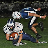 Peabody: Swampscott High School player Richard Sullivan makes a ten yard catch for the games second touchdown leaving Peabody's Aaron McGill behind.  photo by Mark Teiwes / Salem News