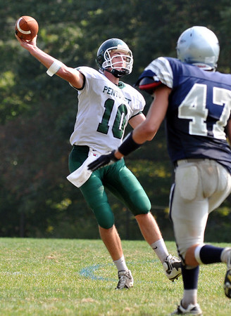Hamilton: Pentucket quarterback Mike Doud releases a pass before Generals defenseman Jake Prince can challenge the ball. photo by Mark Teiwes / Salem News