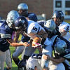 Hamilton: Hamilton-Wenham defense surround Lynnfield's Rick Berardino. photo by Mark Teiwes / Salem News