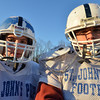 Danvers; St. John's Prep football team practices in preparation for Saturday's Superbowl: Tight ends Owen Lynch, left and Ryan Delisle.  photo by Mark Teiwes / Salem News