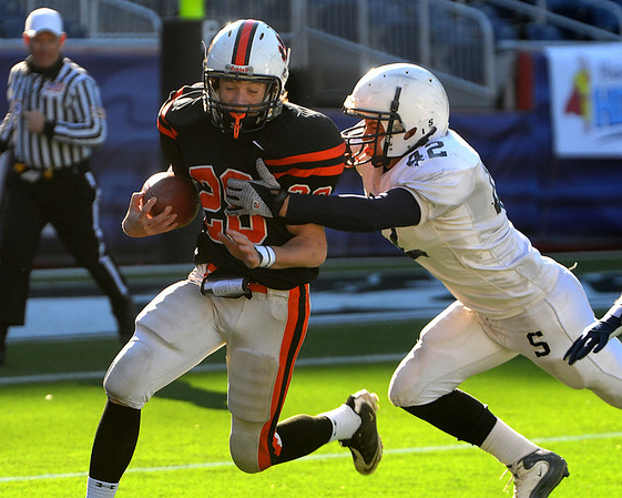 Kenny Pierce has a Somerset player on his heels during the Division 3 Super Bowl at Gillette Stadium on Saturday.<br /> Photo by Ken Yuszkus/Salem News, Saturday, December 4, 2010.