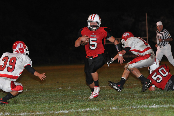 Salem: Senior captain and quarterback Brad Skeffington keeps the ball finding a hole in the defense making a run for a touchdown in the first quarter. photo by Mark Teiwes / Salem News