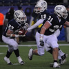 Foxboro:<br /> St. John's Prep's Tyler Coppola gets a handoff from Tommy Gaudet at the St. John's Prep vs Everett High School in the Division 1 Super Bowl football game at Gillette Stadium on Saturday.<br /> Photo by Ken Yuszkus/Salem News, Saturday, December 4, 2010.