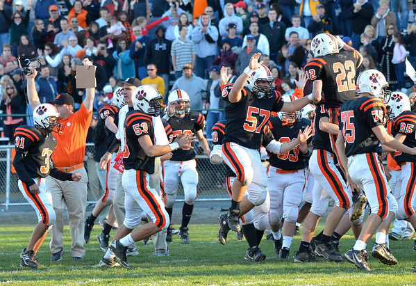 Beverly: Beverly players, coaches and fans celebrate their 21-14 win over Swampscott Saturday at Hurd Stadium. photo by Mark Teiwes / Salem News