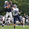 Hamilton: James Love, left, Hamilton-Wenham Regional H.S football player makes a jumping catch off a halfback option 39 yard pass for a touchdown over Triton's Matt Pearson. photo by Mark Teiwes