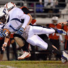 Salem: Peabody's Nathaniel Gaye dives forward on a run past Salem's defense on a drive where he later scored the game's first touchdown. photo by Mark Teiwes / Salem News