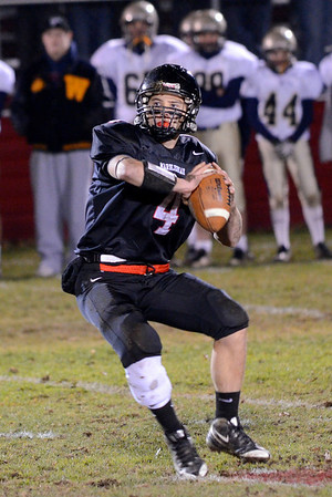 Marblehead: Marblehead quarterback Dan Colbert looks for a pass. photo by Mark Teiwes / Salem News