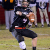 Marblehead: Marblehead quarterback Dan Colbert looks for a pass. photo by Mark Teiwes / Salem News